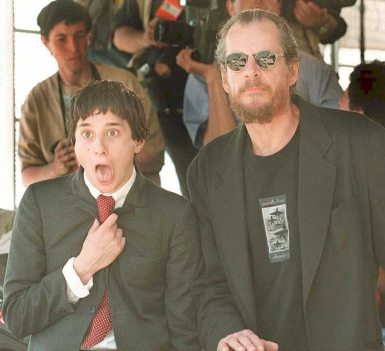 American director Larry Clark (R) poses with scree